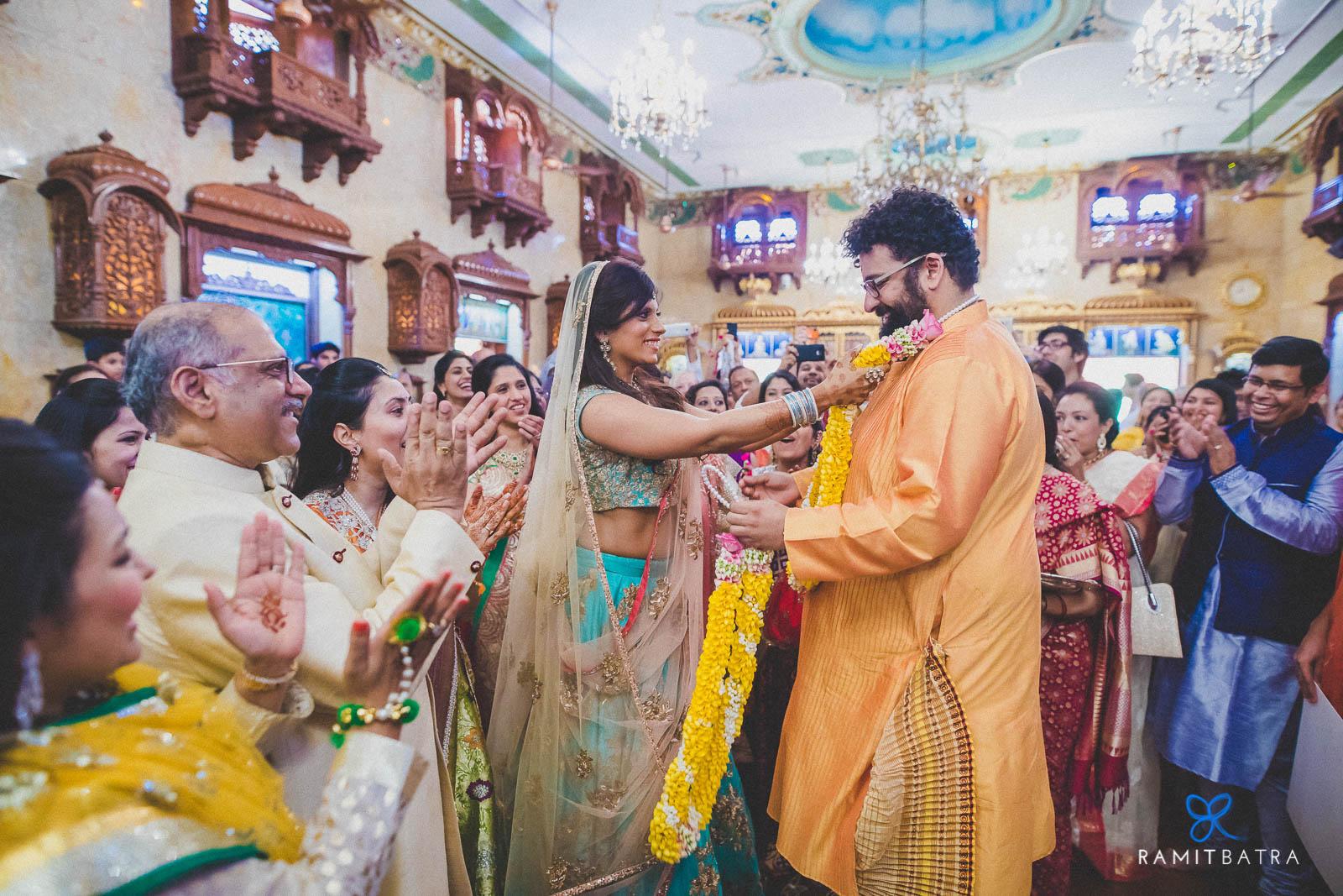 Varmala - Bride & Groom exchange garlands - at Iskcon Temple Mumbai